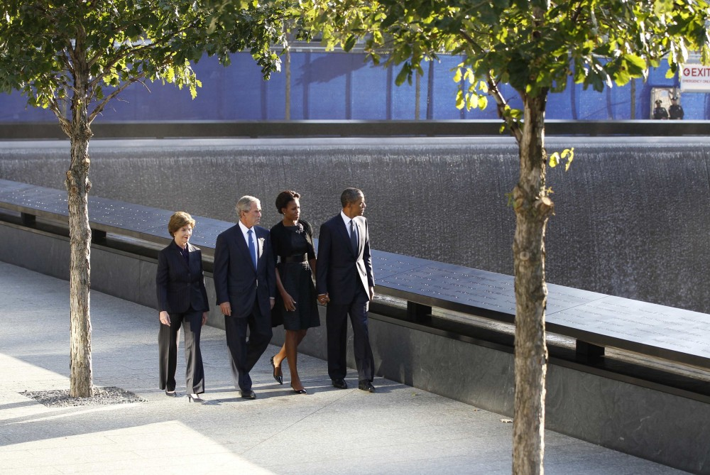 U.S. President Barack Obama, first lady Michelle Obama, former U.S. President George W. Bush and former first lady Laura Bush walk beside the North pool of the WTC Memorial during ceremonies marking the 10th anniversary of the 9/11 attacks on the World Tra