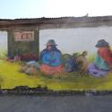 Mural Día de la Mujer Cholita de Sol Reciclando Muros