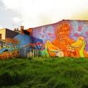 17.-Mural-que-utiliza-dos-fachadas-en-un-lote-ezquinero-de-la-Calle-26-con-una-mujer-que-sostiene-dos-palomas-y-el-texto
