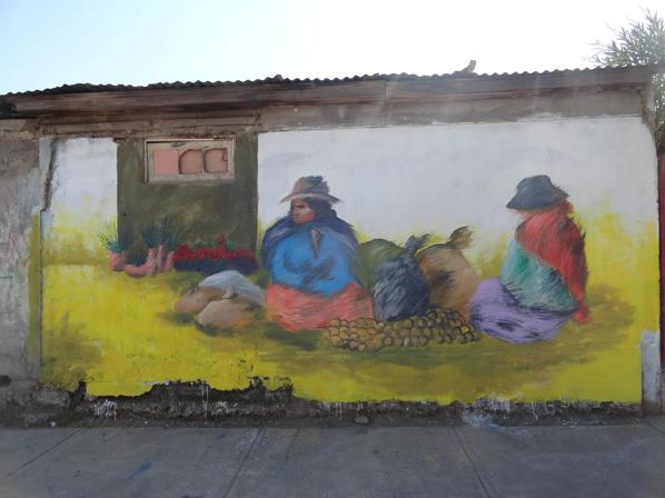 Mural de Sol reciclando muros en el Museo a Cielo Abierto de la Pincoya
